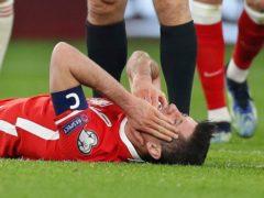 Robert Lewandowski will miss the England game (Laszlo Balogh/AP)