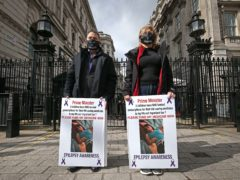Graham and Elaine Levy, whose 27-year-old daughter Fallon has a rare form of epilepsy, protest outside Downing Street (Jonathan Brady/PA)