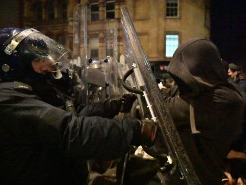Police officers move in on demonstrators in Bristol during the 'Kill The Bill' protest against The Police, Crime, Sentencing and Courts Bill (Ben Birchall/PA)