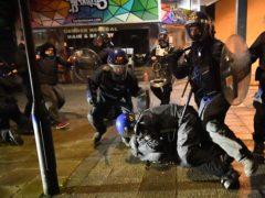 Police officers detain a man in Bristol (Ben Birchall/PA)
