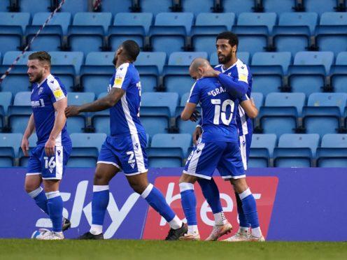 Gillingham's Vadaine Oliver celebrates scoring the winner against Wigan (John Walton/PA)