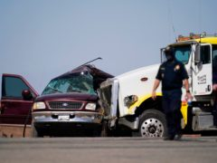 Emergency services at the scene of the crash in Holtville, California (Gregory Bull/AP)