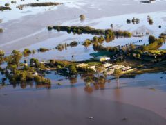 Buildings are partially submerged as floodwater covers large areas north west of Sydney, Australia, Wednesday, March 24, 2021. Some 18,000 residents of Australia's most populous state have fled their homes since last week, with warnings the flood cleanup could stretch into April. (Lukas Coch/Pool Photo via AP)