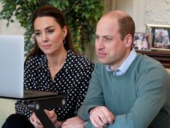 Kate and William chat to a couple whose son was helped by the Shout text helpline (Kensington Palace/PA)