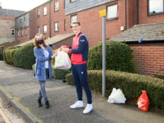 Ryan Yates of Nottingham Forest delivered the one millionth EFL food parcel to Sandie Gee – Husbands (Handout/PA)