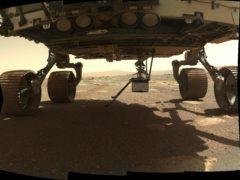 The Ingenuity helicopter is being positioned on the surface of Mars from where it was stowed under the Perseverance Rover (NASA/JPL-Caltech/MSSS)