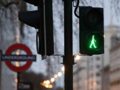 The green man traffic signal has been replaced by a woman at pedestrian crossings in London (TfL/PA)