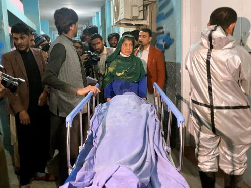Afghans carry the body of a woman who was killed by gunmen in the city of Jalalabad east of Kabul (AP)