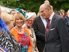 The Duke of Edinburgh meets guests during a garden party held at Hillsborough Castle (PA)