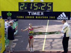 Paula Radcliffe crosses the line to set a new marathon world record (Rebecca Naden/PA)