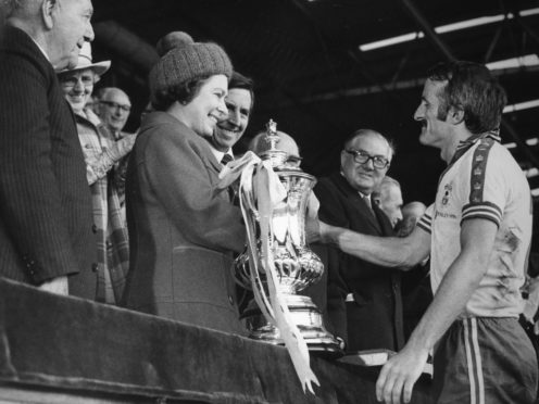 The Queen presents Southampton captain Peter Rodrigues with the FA Cup after the 1976 final at Wembley. (PA Archive/PA)