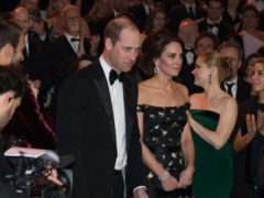 The Duke and Duchess of Cambridge take their seats as they attend the EE British Academy Film Awards in 2017 (PA)
