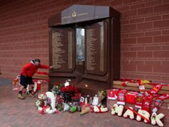 Fans pay their respects at the Hillsborough memorial (Martin Rickett/PA)