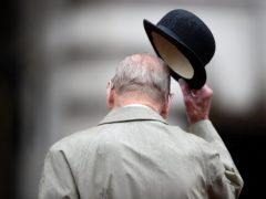 The Duke of Edinburgh raises his hat at the Captain General's Parade (Hannah McKay/PA)