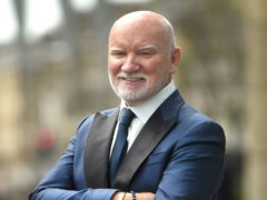 Sir Tom Hunter has given £300,000 in grants and £200,000 in loans (Lesley Martin/PA)