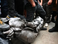 The Edward Colston statue after it was toppled (Ben Birchall/PA)