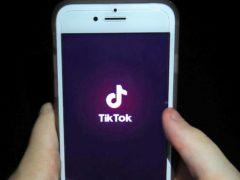 The TikTok app on a smartphone (Peter Byrne/PA)