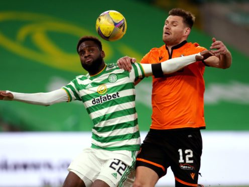 Dundee United's Ryan Edwards, right (Andrew Milligan/PA)