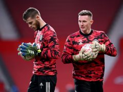 A question mark hangs over which of David De Gea (left) or Dean Henderson (right) will play in goal for Manchester United against Brighton (Laurence Griffiths/PA).