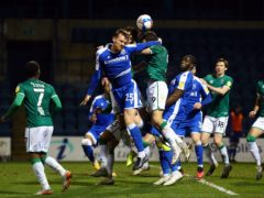 Gillingham's Robbie Cundy, left, is close to a return (Gareth Fuller/PA)