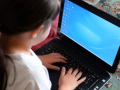 The Government pledged to provide 1.3 million digital devices to help disadvantaged children access remote education during the pandemic (Peter Byrne/PA)