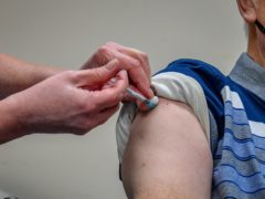 Getting a vaccine is 'one of the safer things you do in the day', an expert has said (Ben Birchall/PA)