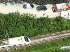 Rescue vehicles near the site of a partial train derailment in Toroko Gorge (National Fire Agency Department via AP)