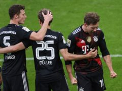 Leon Goretzka, right, celebrates his goal (Alexander Hassenstein/AP)