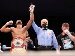 Jamel Herring of the United States, left, has his arm raised in celebration after stopping Britain's Carl Frampton in the sixth round (Kamran Jebreili/AP)