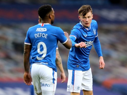 Jermain Defoe and Nathan Patterson (right) both struck during Rangers win over Cove (Jane Barlow/PA)
