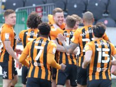Callum Elder (centre) celebrates scoring his first Hull goal (Richard Sellers/PA)