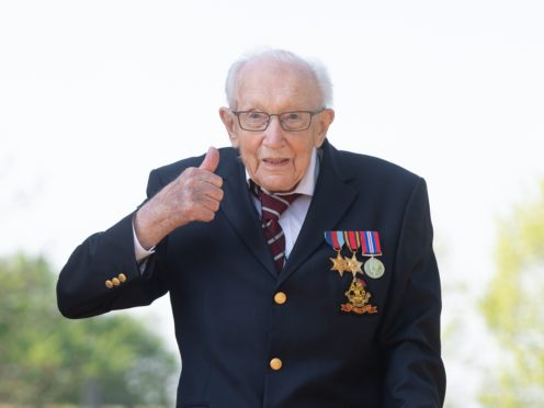 File photo dated 16/04/20 of the then 99-year-old war veteran Captain Tom Moore, at his home in Marston Moretaine, Bedfordshire, after he achieved his goal of 100 laps of his garden. Issue date: Tuesday April 6, 2021.