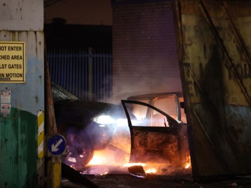 Cars that people on the loyalist side tried to drive through the Peace Gates in Lanark Way, Belfast, during further unrest in Belfast (Liam McBurney/PA)