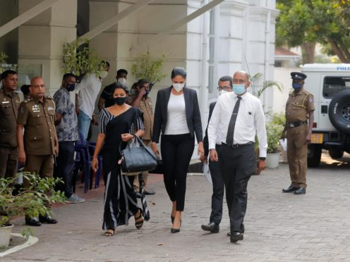 Caroline Jurie, centre, leaves a police station after being bailed in Colombo, Sri Lanka (AP/Eranga Jayawardena)