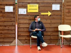 A man waits to get vaccinated with the AstraZeneca Covid-19 vaccine in a vaccination centre of Saint-Jean-de-Luz, south-western France (Bob Edme/AP)
