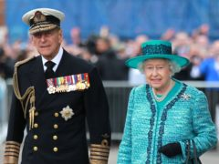 The Queen and the Duke of Edinburgh at the formal naming ceremony for HMS Queen Elizabeth in Rosyth Dockyard (PA)