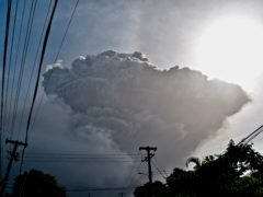 Ash rises into the air as La Soufriere volcano erupts on the eastern Caribbean island of St Vincent (Kepa Diez Ara/AP)