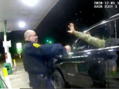 One of two police officers accused of pepper-spraying and pointing their guns at a black US army officer during a traffic stop has since been fired, authorities in Virginia have said (Windsor Police/AP)