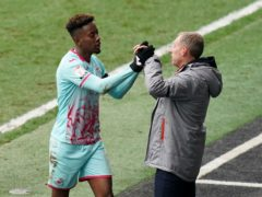 Jamal Lowe (left) is congratulated by manager Steve Cooper (John Walton/PA)