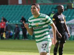 Celtic's Mohamed Elyounoussi celebrates scoring the fifth goal against Livingston (Jeff Holmes/PA).