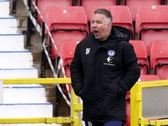 Darren Ferguson's Peterborough blew the chance to seal promotion (Tess Derry/PA)