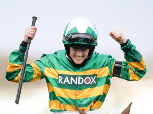 Rachael Blackmore celebrates winning the Randox Grand National Handicap Chase on Minella Times (Alan Crowhurst/PA)
