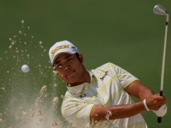 Hideki Matsuyama hits out of a bunker on the second hole during the final round of the 85th Masters (Matt Slocum/AP)