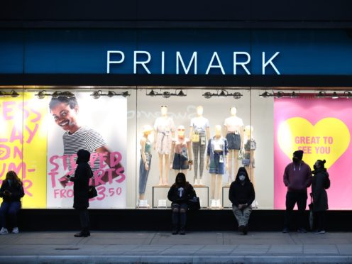 Early morning shoppers stand in line outside the Primark store in Oxford Street, London (Aaron Chown/PA)