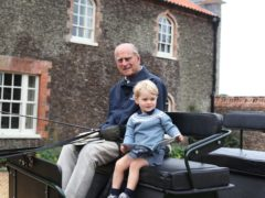 The Duke of Edinburgh with Prince George in Norfolk in 2015 (The Duchess of Cambridge/PA)