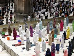 Muslims pray spaced apart at Istiqlal Mosque in Jakarta, Indonesia (Achmad Ibrahim/AP)