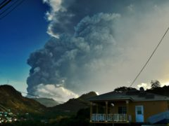 Ash rises into the air as La Soufriere volcano erupts on the eastern Caribbean island of St Vincent (Orvil Samuel/AP)