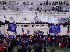 People storm the Capitol in Washington on January 6 (John Minchillo/AP)