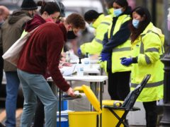 People take part in coronavirus surge testing on Clapham Common, south London (Kirsty O'Connor/PA)