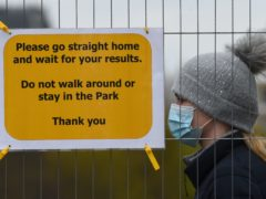 People take part in coronavirus surge testing on Clapham Common (PA)